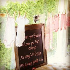 Vintage Baby Shower | Lilyshop Clothesline with pink onesies and dresses?