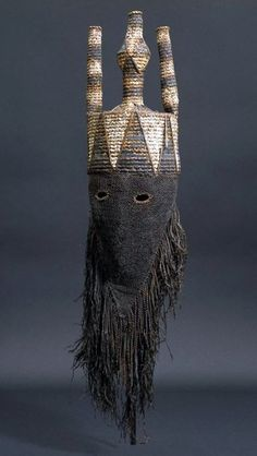 Africa | Mask for the Idangani Society, from the Salampasu people of Lulua Province, DR Congo | Cloth, pigment, wicker and fiber | Early 20th century