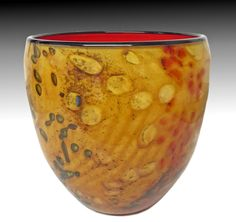 Gold Riverbed Bowl by Thomas Philabaum. This blown glass bowl has a richly colored surface and a pattern reminiscent of the ebb and flow impressions in the wet sand of a riverbed.