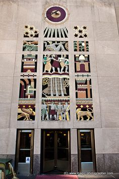Art deco colorful sculpture relief entrance to  45 Rockefeller Plaza building, Rockefeller Center, Manhattan, NYC