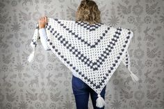 """Put a modern spin on a crochet classic with this simple crochet granny stitch shawl! This free crochet pattern uses Lion Brand New Basic 175 in """"Cream"""" and """"Charcoal."""""""