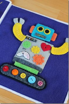 workmanfamily.typepad.com  Super cool homemade robot quiet book! For Max this Christmas?!