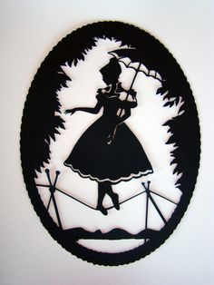 Haunted Mansion tightrope walker paper silhouettes