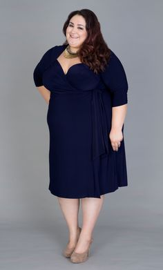 """Real Curve Cutie & Kiyonna's Wholesale Manager Vannessa (3x, 5'8"""") looks AMAZING in this classic silhouette. She dressed up her Sweetheart Knit Wrap Dress with a bold Stella & Dot necklace.  #KiyonnaPlusYou #Kiyonna #PlusSize"""