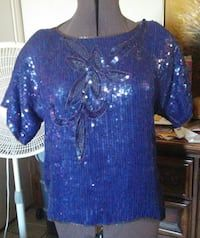 Sequined royal blue with gold beads. Short sleeve. Sz. Medium