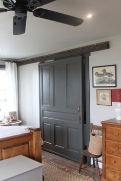 master closet with sliding barn door on Remodelaholic.com. Revere pewter on walls. Dragons breath on barn door. Ben Moore