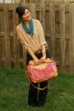 How cute is @sandyalamode wearing our Hydrangea Berry Messenger/Diaper Bag?!