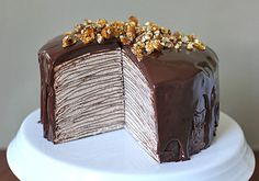 Darkest Chocolate Crepe Cake. This cake consists of layers (upon layers!) of chocolate crêpes. In between the layers is a swiss meringue buttercream that is flavored with Nutella, lightened with a little whipped cream, then finished with a rich chocolate glaze. YUM!