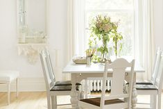 Interior Design Ideas - Classic Off-White Dining Room Colors! A soft, white dining room color using Delicate White PPG1001-1 is clean and classic. Use subtle off-white paint colors like Sugar Soap PPG1084-1 for trim and Chalkware PPG1087-4 for decor. Details and accents can be added with a medium brown like Conservation PPG1027-6 for a classy complement.