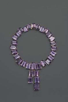 Joan Crawford's amethyst necklace by Ruser from around Rich & luxurious but totally modern. The asymmetry is contemporary, and the proportions are bold. Purple Jewelry, Amethyst Jewelry, Amethyst Necklace, Jewelry Accessories, Jewelry Design, Emerald Jewelry, Antique Jewelry, Vintage Jewelry, Diy Jewelry Making