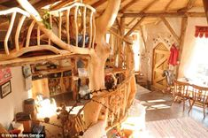 Treebeard: The couple have used a whole tree as a supporting structure for their home, fondly nicknamed the 'hobbit house' by locals