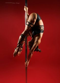 Pole Fitness - Photography by Don Curry. Working on this from my handspring and also right over from the ground.
