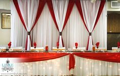 Red and white fall wedding backdrop and head table with lights. Fall wedding ideas