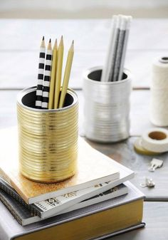 Tin can in metallic gold to hold pencils on desk