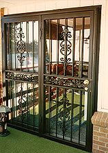Wrought iron security door outside pinterest wrought for Security patio screen doors