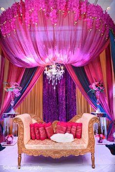 This colorful Indian wedding reception features beautiful floral and decor. @ The Chattanoogan Hotel