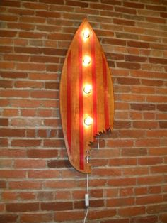 Lighted Vintage Surf Board wall art handcrafted and painted, with dimmer $175 Can be made in any color. Made of Oak