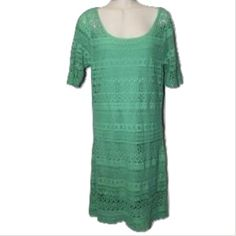 Solitaire Sz S Green Crochet Short Sleeve Dress Solitaire by Ravi KhoslaSz S Green Crochet Short Sleeve Semi Sheer Knee Length Dress NWOT.  Short Sleeve Length 39 Bust 32-34 Cotton/Polyester blend Green Crochet knitted Removable green cami dress slip Anthropologie Dresses