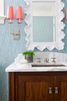 When choosing lighting for a powder room, take a look around the space where you are planning to use your wall sconce and pick a color from your carpet, throw pillows, curtains or decorative pieces. Wall sconce shades come in many different colors and are a great way to pull your area together. Just don't forget - shade transparency, color, and texture can affect how much light is displayed!