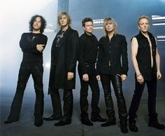 DEF LEPPARD DRESSED IN BLACK THAT'S A HOTTIE PICTURE.