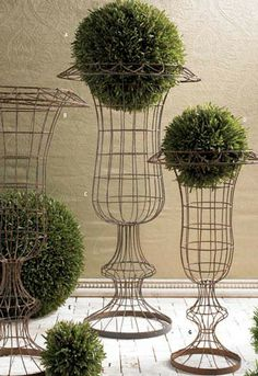 Wire urns are timeless. Use indoors for lasting beauty in those hard to decorate spots like the dining room corner or the foyer. Can be sprayed and used outdoors as well. Available at Pineapple House, Deco Floral, Arte Floral, Urn Planters, Garden Urns, Iron Decor, Garden Accessories, Plant Hanger, Container Gardening, Garden Landscaping