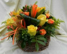 Dark brown basket with handle ( may vary) with pepper berries or sub with hypericum berries, yellow roses, orange spray roses, orange asiatic lilies, solidaster, variegated dracaena leaves $59.99