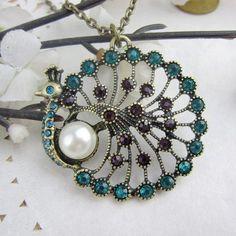 Google Image Result for http://i01.i.aliimg.com/wsphoto/v0/559126857_1/Retro-Pearl-Peacock-Pendant-Necklace-Retro-Jewelry-Free-Shipping.jpg