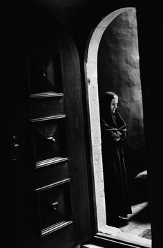 Abbas - SERBIA. Zica. 1995. The Orthodox monastery. A nun stands outside the church during lithurgy inside. S)