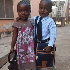 Twins Timothy and Lydia prepare to go out in service in Ilorin, Nigeria. Precious children!!