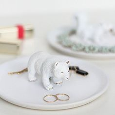 Make these inexpensive and cute figurine trinket dishes with just a few simple items you may already have around the house!
