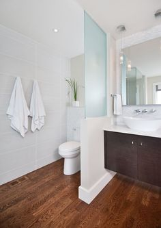 Bring the wall around the toilet area to match Right side around shower