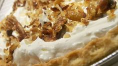 The filling for this decadent pie is a combination of a very creamy, cream cheese and whipped topping. Then toasted coconut and caramel sauce is sprinkled and drizzled over it. Another cream cheese layer is spooned on, and then the pie is finished with more toasted coconut. This recipe makes two fantastic pies.