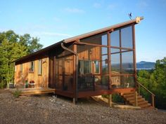 """Couple Builds 704 Sq. Ft. Cabin That 'Fits Like a Glove'. """"We believe a smaller home is better. One reason is that it costs less to build a small home. It takes less energy to heat and cool the space. You will pay less in taxes. When you build a smaller home you can spend some extra money on the space that you do have. Lot's more tips here: http://www.simplyhomenc.com/#less"""