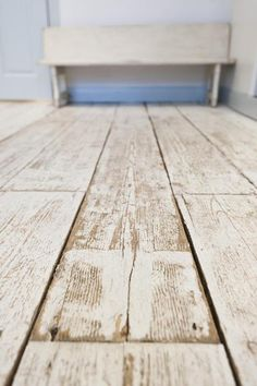 white washed wide plank floor boards