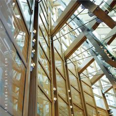 Architectural laminate glass can incorporate a selection of materials; fabric, metal mesh and digital prints as standard, but also bespoke materials such as this larch wood veneer for the Enric Miralles de-signed Scottish Parliament. #architecture #kilnformedglass #architecturalglass #decorativeglass #frostedglass #etchedglass