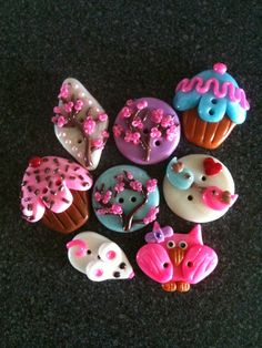 Polymer clay buttons. Cute! They would make super cute necklaces.