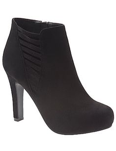 Faux suede ankle boot hits the high notes of the season with perforated details and a tall heel. Available in wide widths with an easy side zipper closure. lanebryant.com