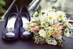 Wildflower bouquet and blue wedding shoes