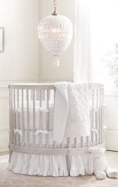 RH Baby & Child's Frayed Ruffle Round Crib Bumper:This charming collection borrows its heirloom appeal from a soft textural blend of cotton and linen. Unfinished edges lend a well-worn, relaxed note to the sweet ruffle trim.