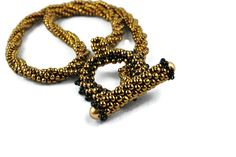 Elegant twisted bronze chain made with Toho bronze and black glass seed beads.Beaded toggle clasp ends with Swarovski glass gold pearls and looks great worn in the front. 18 inches long and weighs only 1 ounce, so it looks heavy but isn't! Handmade Beaded Jewelry, Handmade Bracelets, Beaded Necklace, Beaded Bracelets, Gold Pearl, Black Glass, Artisan Jewelry, Seed Beads, Swarovski