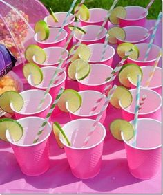 Bright pink solo cups with a slice of lime and a striped straw | baby shower drinks