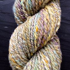 Burbs and the Bees.  2 ply, hand spun, hand dyed with Kool-aid, 100% wool from raw fleece.