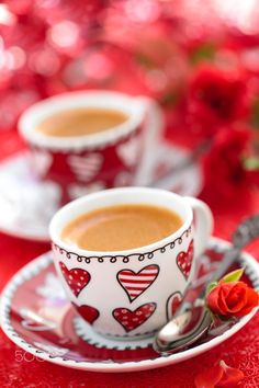 Coffee for Valentine day. - Cups of coffee and roses for Valentine day.