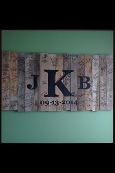 My husband made a sign out of pallet wood and painted our monogram and wedding date on it. For our unity ceremony we nailed the three middle planks in to complete the K. Then we took the sign to our reception and had guest sign it for our guest book.