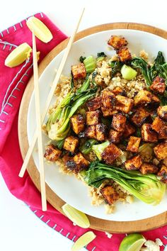 Crispy tofu that's baked not fried and tossed in a 5-ingredient peanut glaze! Serve over cauliflower rice with sauteed veggies for a completely plant-based meal that's entirely vegan   gluten free!