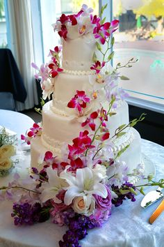 wedding cake with fuschia orchid flowers. LOVE IT!!!!!!!!!!!!!!!!!!!!!!!!!! I Love the pink orchids!!!!!!!!!!!!!!!!!