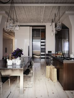 Stainless, rustic ceiling, light fixtures, wood, exposed pipes... Great mix of textures