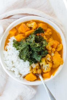 This vegan Cauliflower Sweet Potato Chickpea Curry is the ultimate comfort dish bursting with robust Indian spices and sweetened with coconut milk! It makes for a fabulous lunch or dinner #eatgoodfeelgood #vegan #dinner