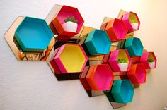 Love these hexagon mirrors from Ikea, but maybe only a couple of boxes instead of on every mirror.