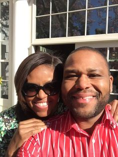 6april2015---first lady michelle obama with anthony anderson at 2015 white house easter egg roll